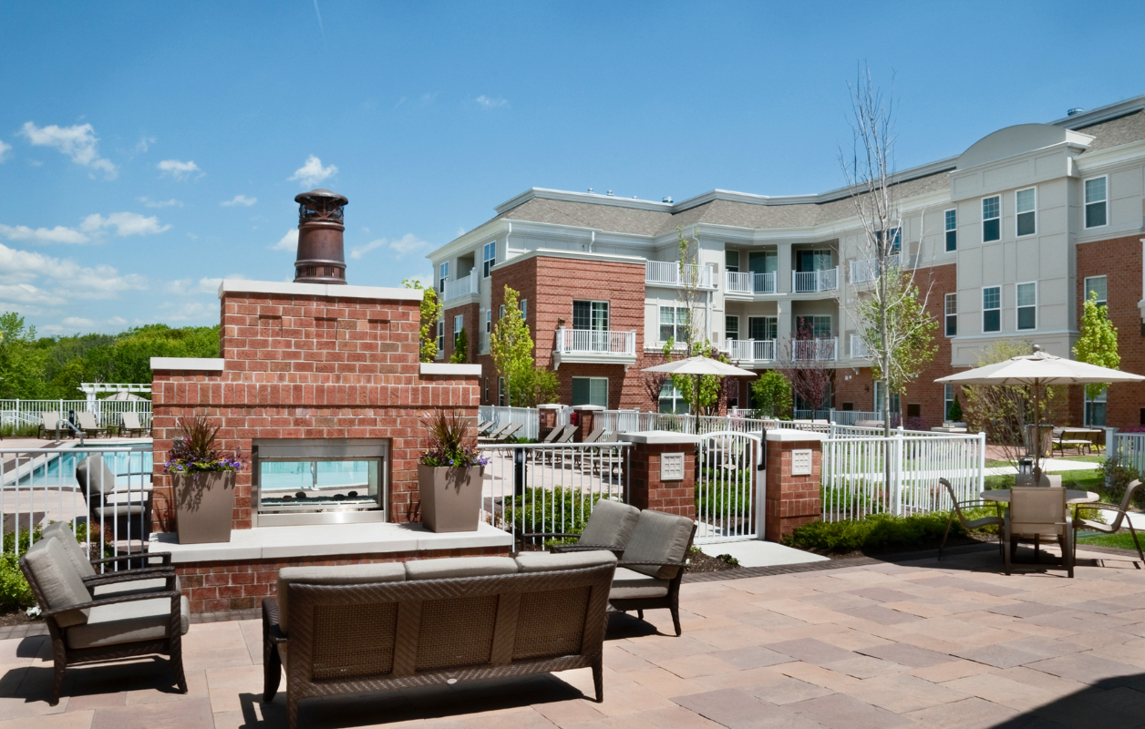 photo of outdoor fireplace lounge and pool area at Highlands at Hilltop apartments by RHO Residential in Verona, NJ