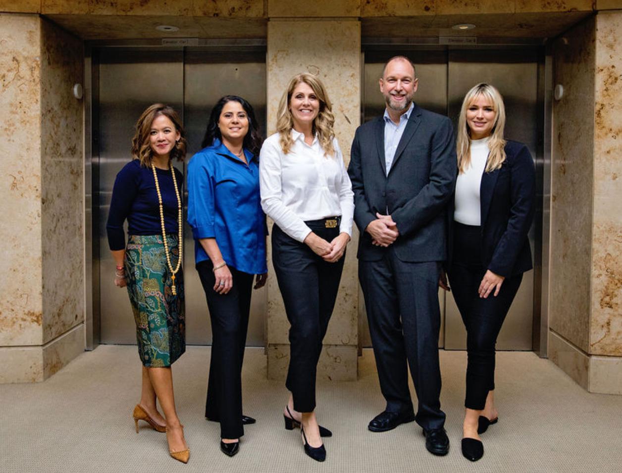 color photo of RHO Residential team left-to-right: Angelica Facchini, Gabriel Buchanan, Brenda Cicoe, Tim Kelly and Gina Barretti
