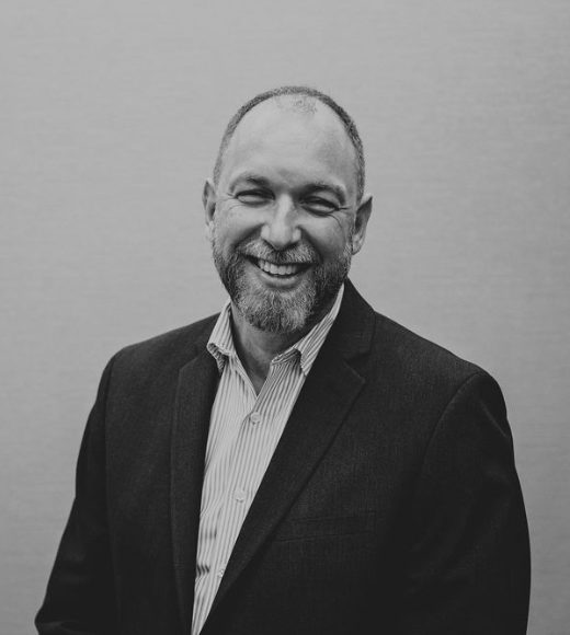 black and white photo of Tim Kelly, CFO at RHO Residential